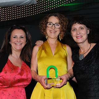 Gwyn being presented with award by Magic Handwriting