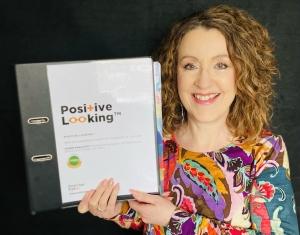 Gwyn holding the Positive Looking Folder