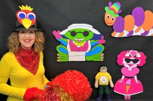 Gwyn ready to go live on the Story Time Show with colourful characters around her