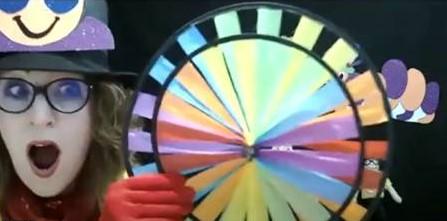 Gwyn-Gwyn-Gwynnie-Gwyn-Gwyn spinning the rainbow wheel on the show